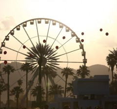 epa03660123 A view of the Coachella ferris wheel at the Coachella Music and Arts Festival in Indio, California, USA 12 April 2013. The festival runs until 14 April.  EPA/STEVEN C. MITCHELL