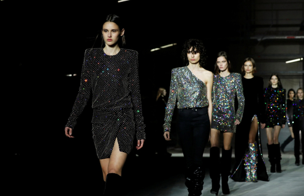 Models present creations by designer Anthony Vaccarello as part of his Autumn/Winter 2017/18 women's ready-to-wear collection for fashion house Saint Laurent during Fashion Week in Paris, France February 28, 2017. REUTERS/Gonzalo Fuentes